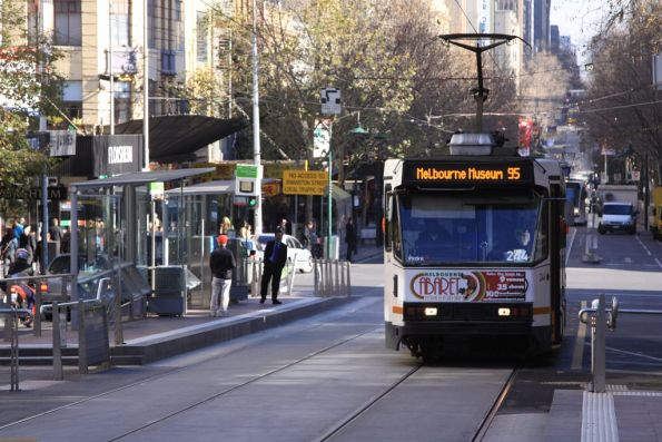 A1.244 heads eastbound with a route 95 Melbourne Museum service