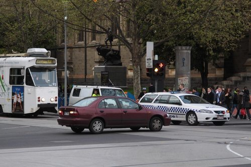Z1.92 waiting to cross the blocked intersection of Flinders and Swanston Streets, the police can't get through either!