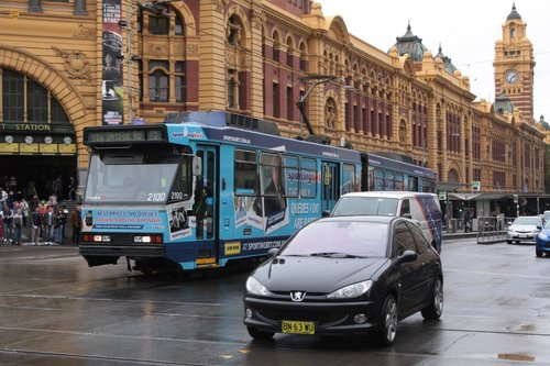 'Sportingbet' advertising on a tram outside Flinders Street Station