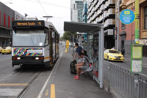 A2.272 heads south on Spencer Street at Bourke with a route 75 service