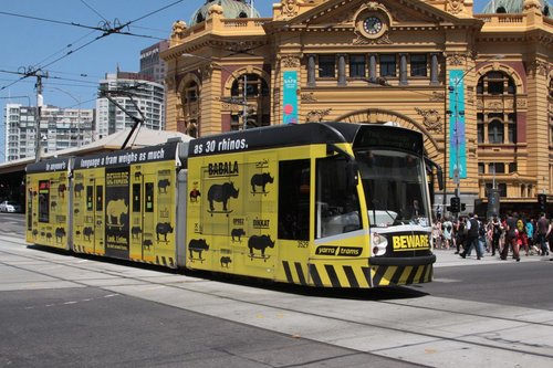 D1.3529 advertising 'Beware the Rhino' outside Flinders Street Station