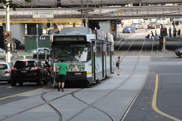 Driver throws the points for a southbound route 55 tram short-shunting at Market Street