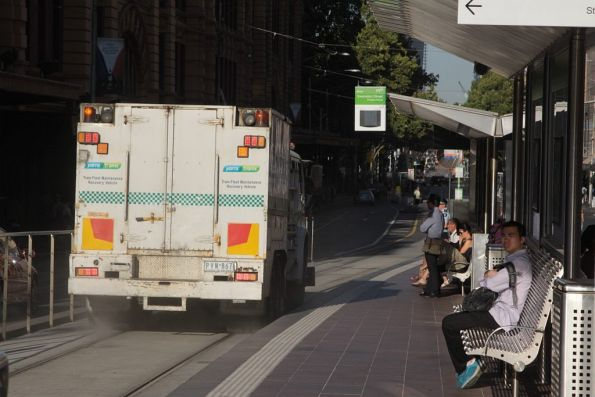 Recovery truck R10 heads west down Flinders Street