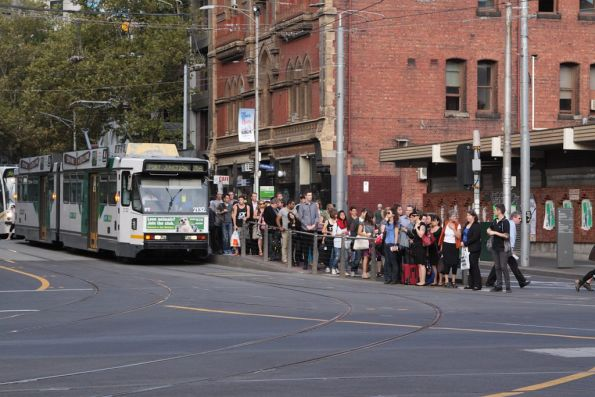 Hoards of passengers attempt to leave the tram stop at Bourke and Spencer Streets