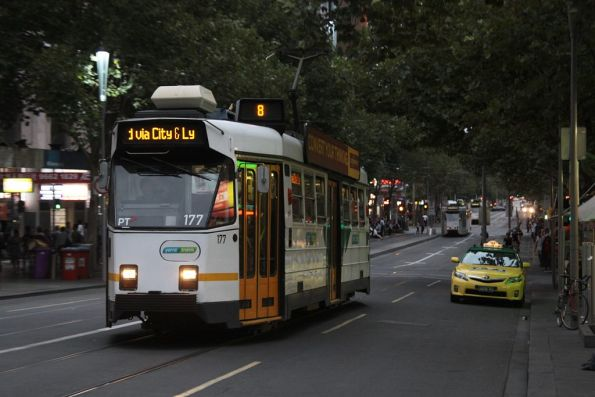 Z3.177 with a destination board stuck on 'scroll' heads north up Swanston at Lonsdale Street