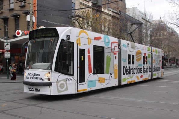 D1.3537 advertising 'TAC: Distractions lead to disaster' northbound at Swanston and Bourke Street