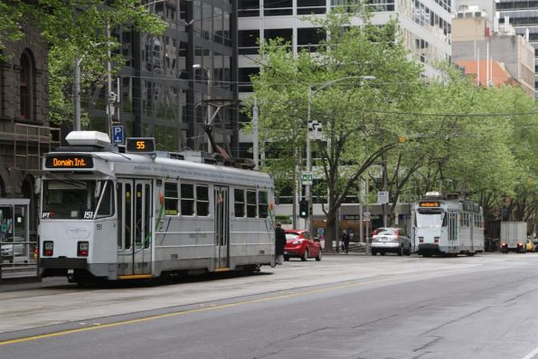 Pair of route 55 trams chase each other south along William Street: Z3.151 behind Z3.207