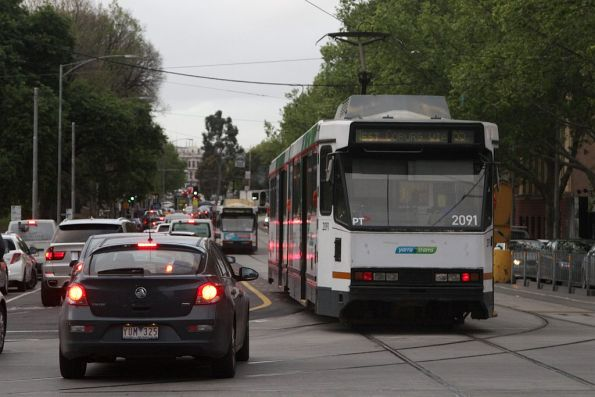 B2.2091 follows another route 55 tram north up William Street