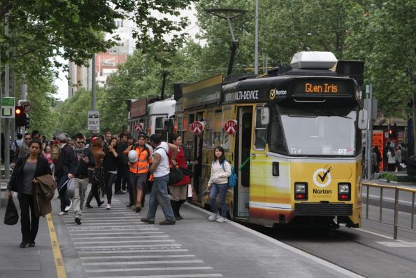 Passengers disembark southbound trams at the Melbourne Central tram stop