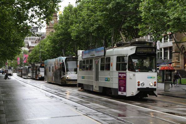 Z1.59 leads a queue of southbound trams at Flinders and Swanston Streets
