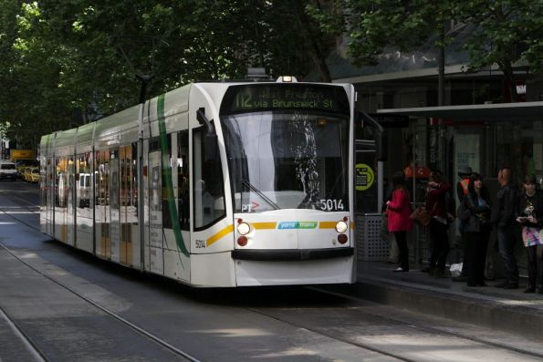 D2.5014 with a route 112 service heads east on Collins Street at Swanston