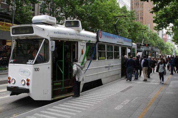 Passengers board southbound tram Z1.100 at Collins and Swanston Streets