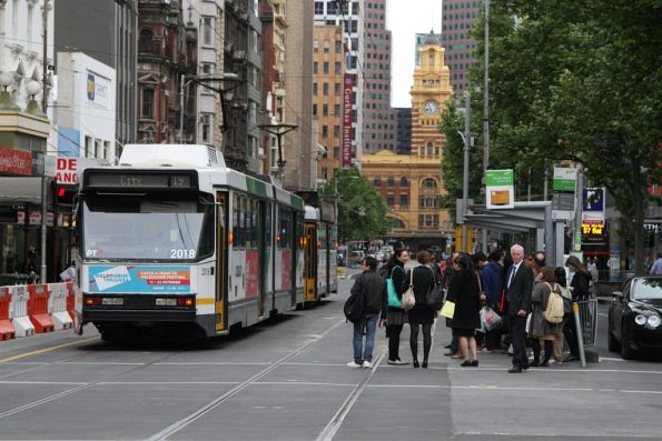 Stopped trams on Elizabeth Street due to an ill passenger
