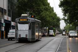 Pair of route 57 trams follow each north along William Street