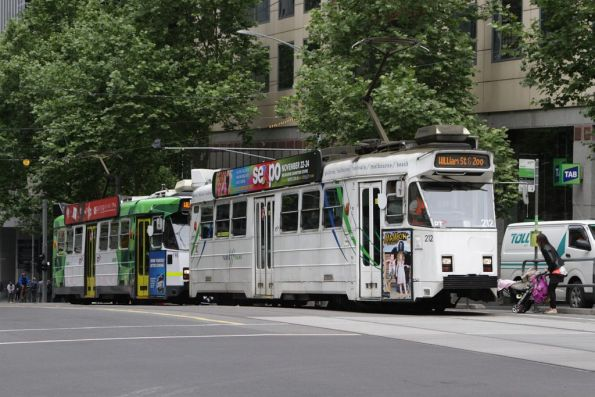 Pair of route 55 trams chase each other down William Street, led by Z3.212 at Collins Street