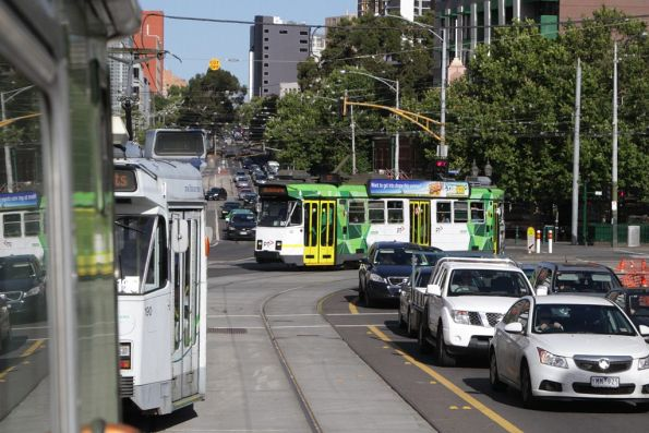 A trio of Z3 class trams on route 57 wait to turn from Victoria Street into Elizabeth