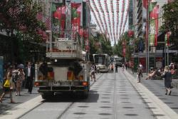 Yarra Trams bucket truck heads along the Bourke Street Mall to another job
