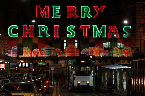 Z3.159 stands beneath the 'Merry Christmas' sign at Flinders Street Station