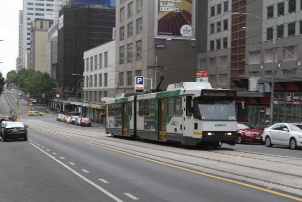 An out of service B2.2015 heads east along La Trobe Street at Swanston