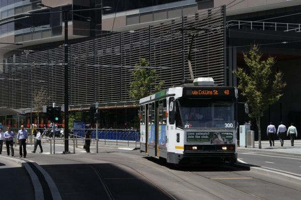A2.300 with a westbound route 48 service heads along the most recent Collins Street tramway extension