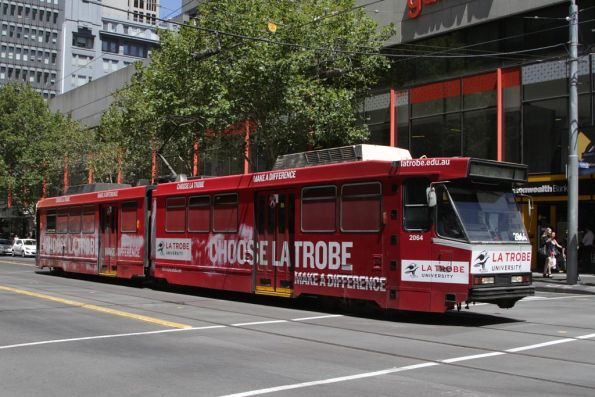 B2.2064 advertising 'La Trobe University' northbound at the corner of Elizabeth and Bourke Streets
