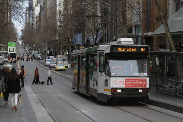 A1.238 heads east on a route 11d service via Miller Street, at Collins and Swanston Streets
