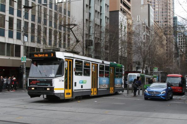 A2.265 heads east with a route 31 service at Collins and Swanston Streets