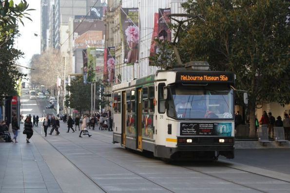 A2.298 heads east in the Bourke Street Mall with a route 96a service to Melbourne Museum