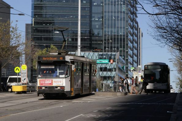 A2.267 heads east with a route 48 service along Collins Street at Batman's Hill