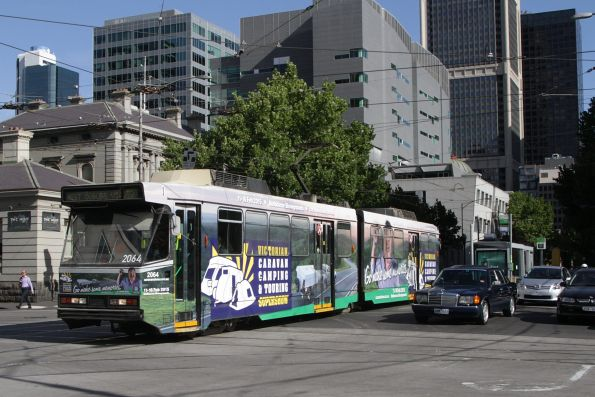 B2.2064 advertising 'Victorian Caravan, Camping & Touring Supershow' on route 55 at William and La Trobe Street