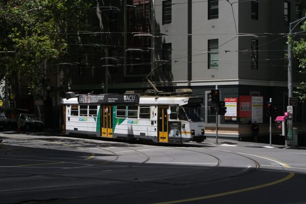 Z3.150 turns from Flinders Lane into William Street with a route 55 service