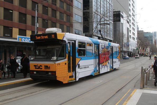 A2.278 advertising 'TAC' heads east on route 70 at Flinders and King Street