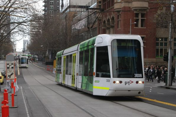 C.3008 headed east on route 109 passes the closed tram stops at Collins and King Street