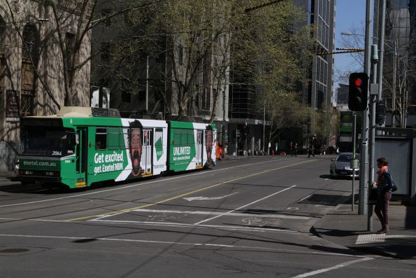 B2.2064 on route 55 advertising 'Exetel' heads west at Flinders Lane and Market Street