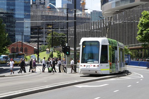 C.3006 heads west along Collins Street with a route 48 service at Collins Landing