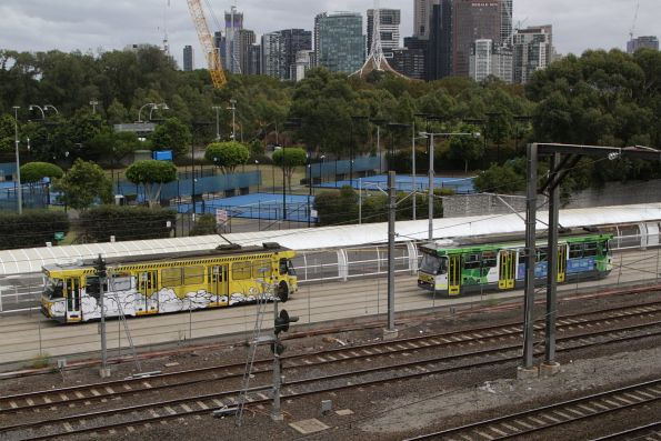 Pair of A class trams on route 70 cross paths on the reserved track at Melbourne Park