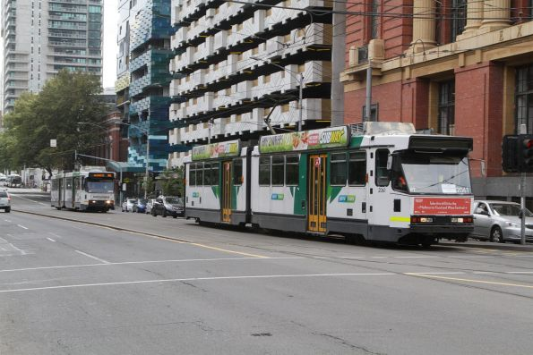Pair of B2 class trams head south on route 86 at Spencer and Bourke Street