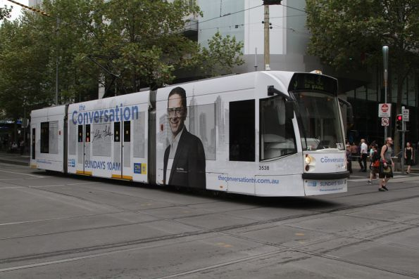 D1.3538 advertising 'The Conversation' southbound on route 3 at Swanston and Bourke Street