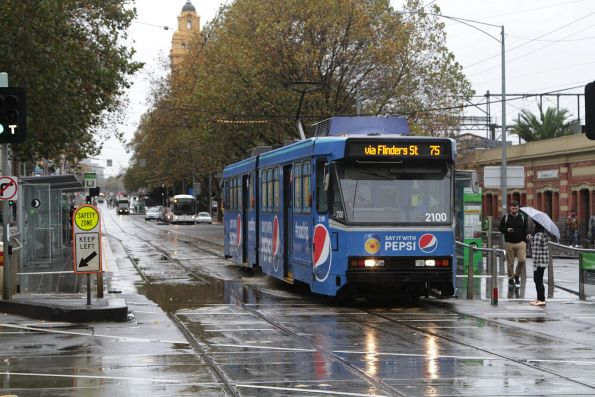 B2.2100 passes through floodwater at Flinders and Market Streets