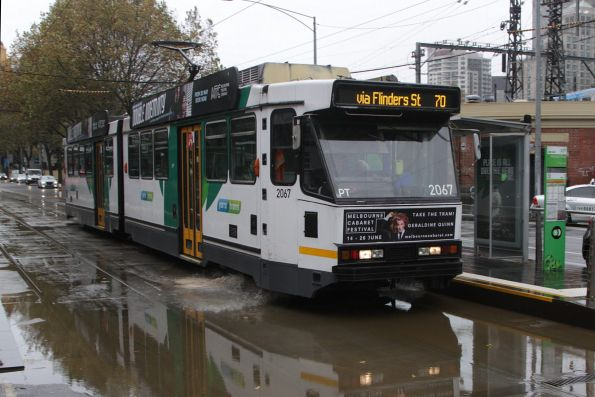 B2.2067 passes through floodwater at Flinders and Market Streets