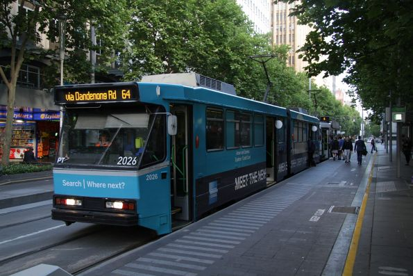 B2.2026 advertising 'American Express' heads south on route 64 at Swanston Street and Flinders Lane