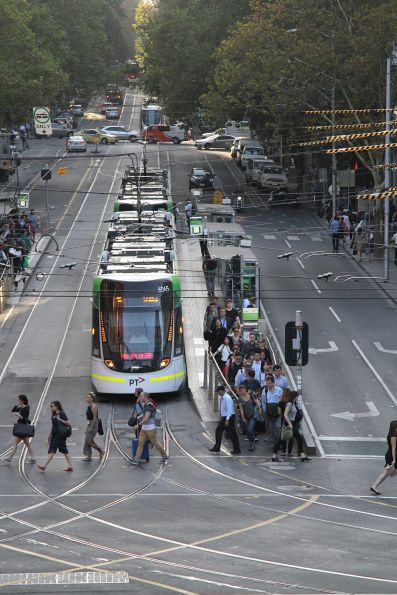 E.6045 leads a queue of westbound trams at Bourke and Spencer Street