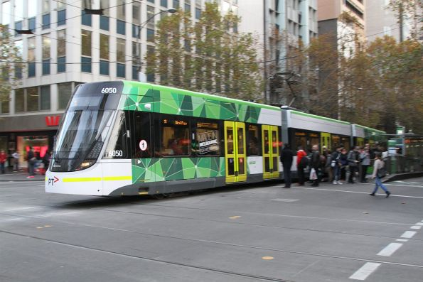 E.6050 heads east on route 11 at Collins and Swanston Street