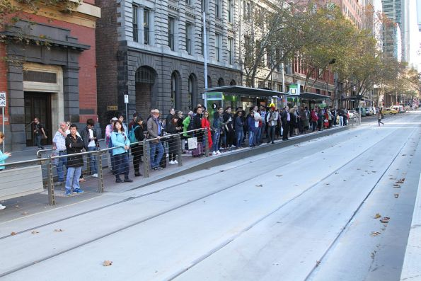Overcrowded tram stop at Bourke and Spencer Street