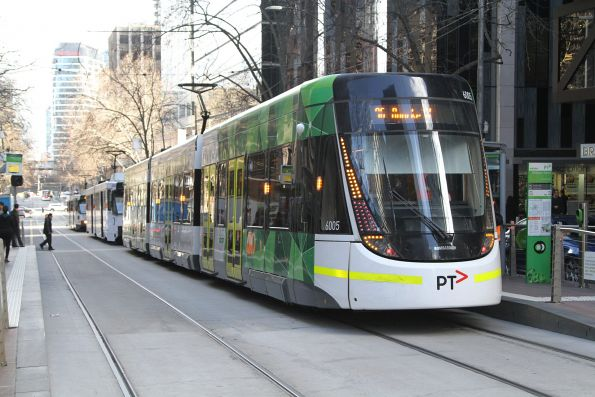 E.6005 leads a queue of eastbound trams at Bourke and William Streets