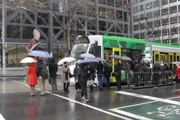 Overcrowded tram stop on route 58 at William and Bourke Street