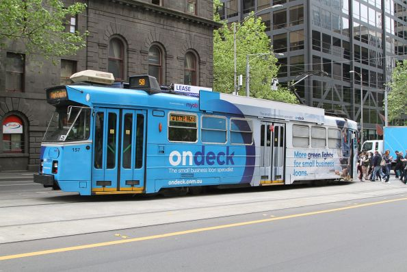 Z3.157 advertising 'OnDeck' heads south on route 58 at William and Bourke Street