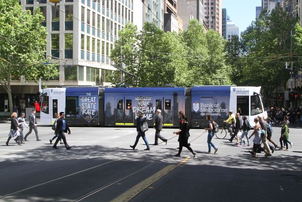 D1.3502 advertising 'Bank of Melbourne' heads north on route 6 at Swanston and Collins Street