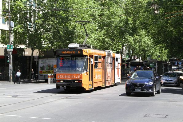 A1.242 advertising 'Avene' heads east on route 12 at Collins and Swanston Street