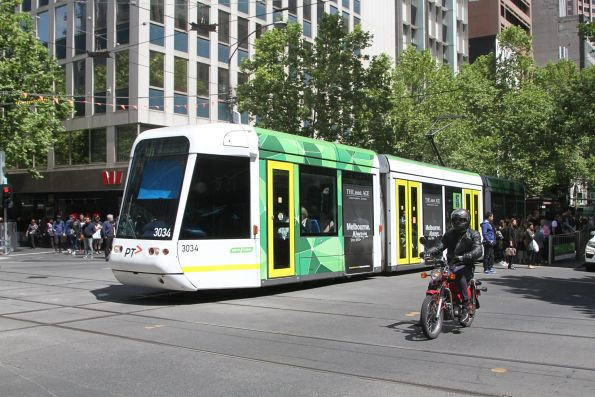 C.3034 heads east on route 109 at Collins and Swanston Street